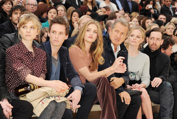 Rosie Huntington-Whiteley and others on Burberry's front row, and models file backstage photos